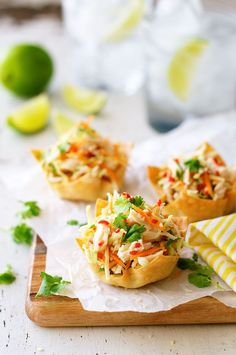 Thai Chicken Salad Wonton Cups - wonton wrappers make great party food! These are filled with a fresh, zingy Thai chicken salad.