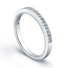 Jeff Cooper R3112B Wedding Ring  This Jeff Cooper wedding band is channel set with princess cut diamonds.