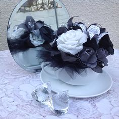 Black, white and grey flowers in tea cup