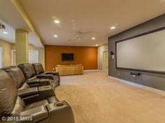 Transitional Home Theater with Carpet, Ceiling fan, Columns, High ceiling