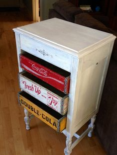 Upcycled Victrola into a coca cola and other vintage soda case dresser!
