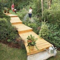 A wooden walkway between house and garage