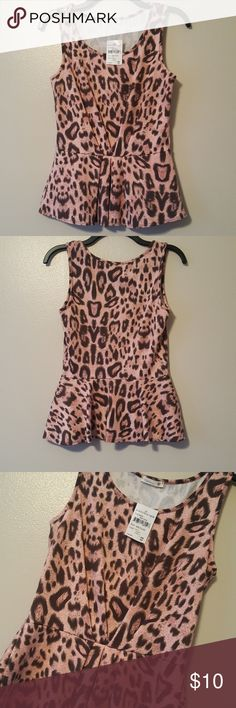 NEW Soprano leopard print peplum top -NEW WITH TAGS  -Size is Medium -Brand is Soprano -Color is pink and brown -95% Polyester 5% Spandex  **All items come from a smoke free and pet free home  **I ship daily  Feel free to send offers and check out my other items for bundle discounts :)  Have a wonderful day!! Soprano Tops
