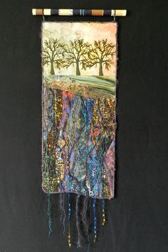 Rooted. Art Quilt by Eileen Williams hanging from a hand painted dowell.