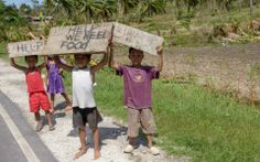 Along the roadside on the way to World Vision's distribution in north Cebu island, children and adults hold up signs to cars driving by, begging for food and water. Jon Warren/World Vision) Story Video, Cebu, Children And Family, News Stories, Philippines, No Response, Hold On, Signs, World