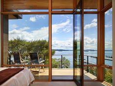 PIvoting door: custom Great Northwest Door,  traditional deck by DeForest Architects