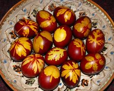 Easter eggs colored with onion shell an leaves in a traditional romanian plate.