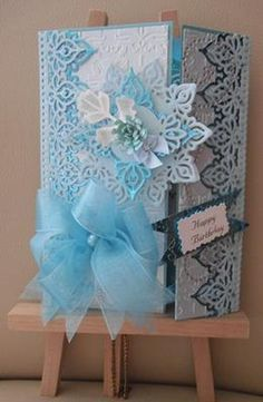 Blue Birthday: This card is just a simple birthday card, one sheet of A4 blue, 2 sheets of A4 blue foil,2 sheet of A4 white.   Spellbinders dies Persian Accents and Motifs