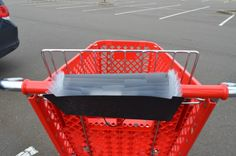 You can make a great organizer for your coupons that hooks over the handle of your cart.