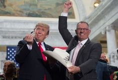 President Trump with Bruce Adams, Chairman of the San Juan County Commissionr, after signing the proclamation shrinking Bears Ears and Grand Staircase-Escalante national monuments. CREDIT: SAUL LOEB/AFP/Getty Images.  The sale to stake holders begins 2/2/18 and the destruction begins.