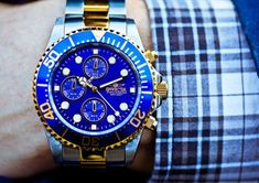 Nice blue face to go with the gold and silver. Love this invicta watch!