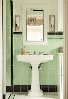 mint tile bathroom - I swear we had this bathroom just off the kitchen when I was small. It's just wonderfully retro.