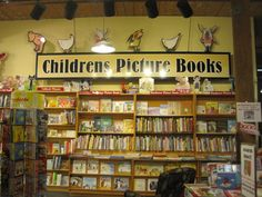 These are standard wall tables against a high wall. Signage and use of publisher POP add an adorable touch at the Toadstool Bookshop. Bookstores, Libraries, Wall Tables, High Walls, Bookcases, Your Space, Signage, Touch, Pop
