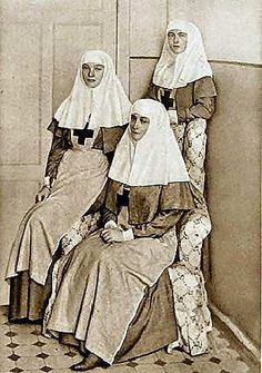 Grand Duchess Olga, standing, Grand Duchess Tatiana and their mother, Empress Alexandra, in their nurse uniforms. All three served as Red Cross nurses during WWI. Alexandra Feodorovna, Nurse Pics, Nurse Stuff, History Of Nursing, Grand Duchess Olga, Vintage Nurse, Tsar Nicholas Ii, Nurses Day, Imperial Russia