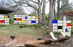 Outdoor privacy. Translucent fiberglass panels. Design by SCLA; inspired by painter Piet Mondrian.