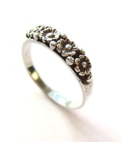 SOLD. Vintage sterling silver flower ring, daisy floral band with pellets, botanical jewellery, forget me not sweetheart ring, flower lover. https://www.etsy.com/listing/259726731/vintage-sterling-silver-flower-ring