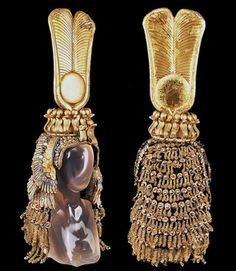 "Double Plumes and uraei circlet with wig overlay as worn by Elizabeth Taylor int he 1963 movie, ""Cleopatra"".   This piece was designed and excuted by costuming legend, Irene Sharaff.   Ironically, the ensemble was formerly owned by film star, Debbie Reynolds until the 1990's, Reynolds' husband, Eddie Fisher (father of Carrie Fisher) had left Reynolds for Taylor prior to Cleopatra. Elizabeth Taylor later left Fisher for co-star Richard Burton."