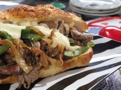 Philly Cheese Steak with Smoked Gruyere Sauce  Recipe courtesy Nadia G  Show: Nadia G's Bitchin' Kitchen Episode: Hitched & Ditched