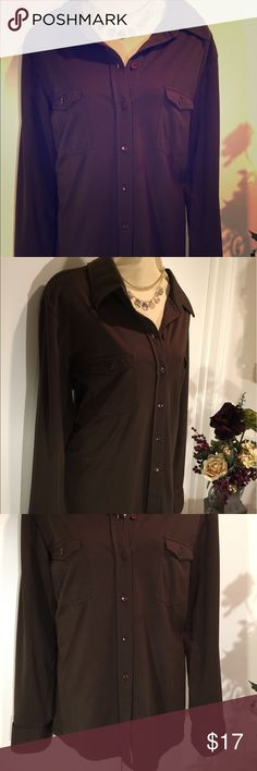 Express Tricot Classic Portofino Fit Shirt Express Tricot Classic Portofino Fit Shirt: a merger of classic shirt confidence with sexy, silky fabric. This classic cut is slightly tailored and relaxed with dramatic cuffs and collar which allows a casual or dressy experience. Shirt is a rich mocha color and in excellent shape. Size: XL Express Tops Button Down Shirts