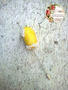 pin with yellow silk cocoon