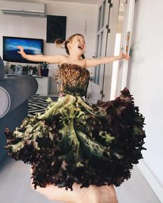 """Alya Chagler """"dresses"""" her daughter In food and flowers by using forced perspective. - photo by Alya Chagler, via BoredPanda Optical Illusion Images, Optical Illusions, Creative Photos, Creative Art, Animation Photo, Forced Perspective Photography, Mom Dress, Dress Skirt, New Star"""