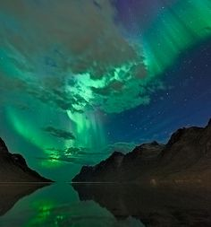 """'EQUINOX AURORAS: Last night, the sun's magnetic field near Earth tipped south. This opened a crack in Earth's magnetosphere. Solar wind poured in and fueled a magnificent display of arctic Northern Lights. Thilo Bubek took the picture not far from Tromsø, Norway. """"We had some nice auroras,"""" he says, with what can only be described as Norwegian understatement.'"""