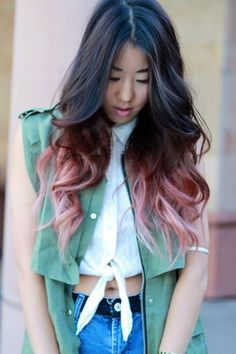 Asian with long black and pink tip hair.