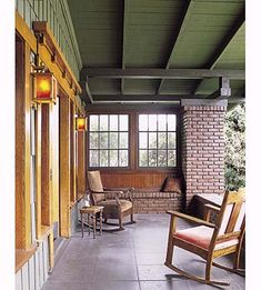 I love the relaxing atmosphere of this restored 1911 Craftsman-style covered porch. With all the extra seating provided by the brick benches, it's the perfect spot to hang out with a bunch of friends on a lazy summer day or lounge about with a blanket and book on a quiet spring evening.