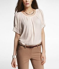 Khakis work for business casual. Make sure they're dressed up and made of a dressier material. Avoid cotton khakis.