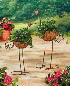Instantly make a statement in your garden with a Set of 2 Crane Planters. Each planter features a liner basket made of coconut fibers, a perfect bed for any plaYour beautiful outdoor landscape isn't complete without some fun garden decor. Garden Crafts, Diy Garden Decor, Garden Projects, Garden Art, Metal Art Projects, Metal Yard Art, House Plants Decor, Iron Decor, Flower Pots