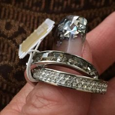 Michael Kors Intertwined Ring. NWT Gorgeous set of intertwined pave baguette crystal rings. Little big on me so never wore.  Size 7 MICHAEL Michael Kors Jewelry Rings