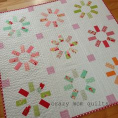 "crazy mom quilts: waiting quilt - made using a 2.5"" Candy charm pack.  38"" square"