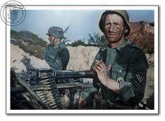 Kulometčík z 19. tankové divize Wehrmachtu s MG-34 na trojnožce. Východní fronta, nedaleko Dimitriewky, červenec 1942. Maschine gunner from 19th Panzer Division of the wehrmacht with mg-34 on a tripod. Eastern front, near dimitriewka, July 1942.