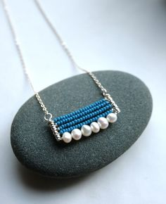 jewelry. simple pendant with pearls and seed beads