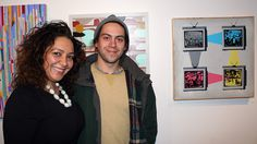 Roula David (left) and Jesse Kassel pose by Kassel's painting at Inner State Gallery.