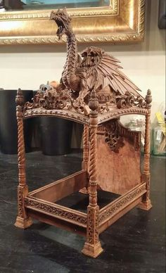 An amazing 1/12th scale bed by Michael Reynolds, IGMA Artisan. (jt-no link but 'go large' to see the detail on this amazing miniature bed)