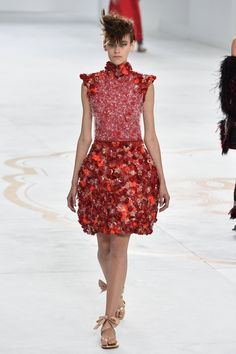 Pin for Later: So You Say You're a Chanel Fan? Haute Couture Autumn 2014 Embellishments and pops of colour enriched a collection that was somewhat taken back and focussed a lot more on shapes, silhouettes, and tailoring.