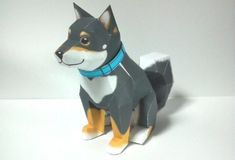 Chobi Dog Paper Toy - by Ten Pepakura  - == -  From Japanese website Ten Pepakura here is a beautiful paper model of a dog. The model takes only one sheet of paper and when assembled measures approximately 10 inches tall.