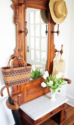 entryway with antique Victorian hall tree; via A Country Farmhouse - My parents were antique dealers (out of our house) and we did love our rotating hall trees. Victorian Hall Trees, Antique Hall Tree, Victorian Decor, Door Hall Trees, Door Tree, Hall Stand, Entry Hall, Entry Mirror, Old Doors
