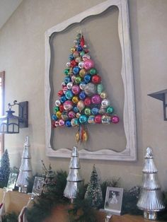 Super cute idea and would be adorable with vintage ornaments Christmas tree made out of ornaments. I would do mine on burlap or velvet depending on the theme.
