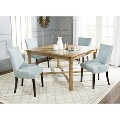 Family meals are deliciously relaxed with the farmhouse style of the Bleeker dining table in elm with a warm oak finish. Recalling English country designs, this beautifully grained table features bead board edges and carved legs with cross stretchers.