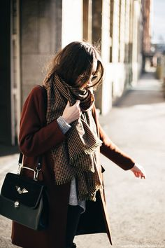 How to style oversized check scarf with rust red minimal coat outfit