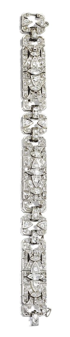DIAMOND BRACELET, CIRCA 1925. Designed as three articulated segments of geometric design joined by open rectangular links, set with 5 marquise-shaped diamonds and 161 round and single-cut diamonds weighing a total of approximately 8.15 carats, mounted in platinum, length 7 inches.