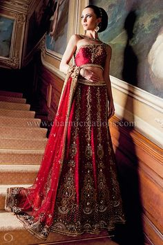Indian Bridal Wear - 12 panel maroon bridal lengha with a short one-shoulder blouse and antique gold jardosi work