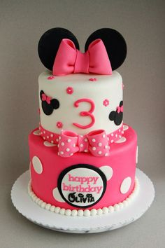 """Happy 3rd birthday Olivia! A 6""""/8"""" Minnie Mouse cake filled with polka dots, bows, and lots of pink. Inside are ombré pink cake layers as well. I loved using the Disney font to complete the look. Cake design modified from Cuteology Cakes."""