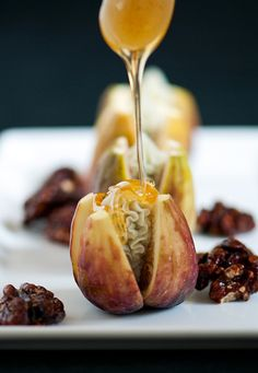 Fresh Figs with Blue Cheese and Honey 2 dozen fresh figs (brown turkey-find at whole foods)  4 oz Gorgonzola dolce blue cheese, room temp, a good honey, candied walnuts (optional)  Top the figs and cut into quarters from the top down to, but not completely through, the base of the fig. Cream or whip the blue cheese (this won't work with crumbly blue cheese!) and fill a piping bag. Pipe cheese into the center of each fig. Drizzle honey over the figs and serve with candied walnuts