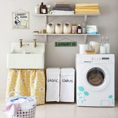 I would love to have this farmhouse style sink, with the skirting too. Putting decals on the washer dryer - such a fun idea!