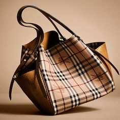 The classic Haymarket check tote bag from Burberry is updated with soft side pockets