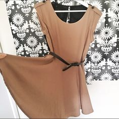 One day sale Double zero nude black skater dress Nude base black rule detail on the back belted (belt is included ) skater dress . Good for size S/M. Has Two pockets Double Zero Dresses Mini