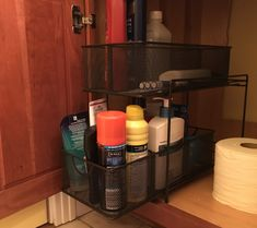 Maximize space under your bathroom cabinet with this shelf unit available at Target, Amazon and other retailers.
